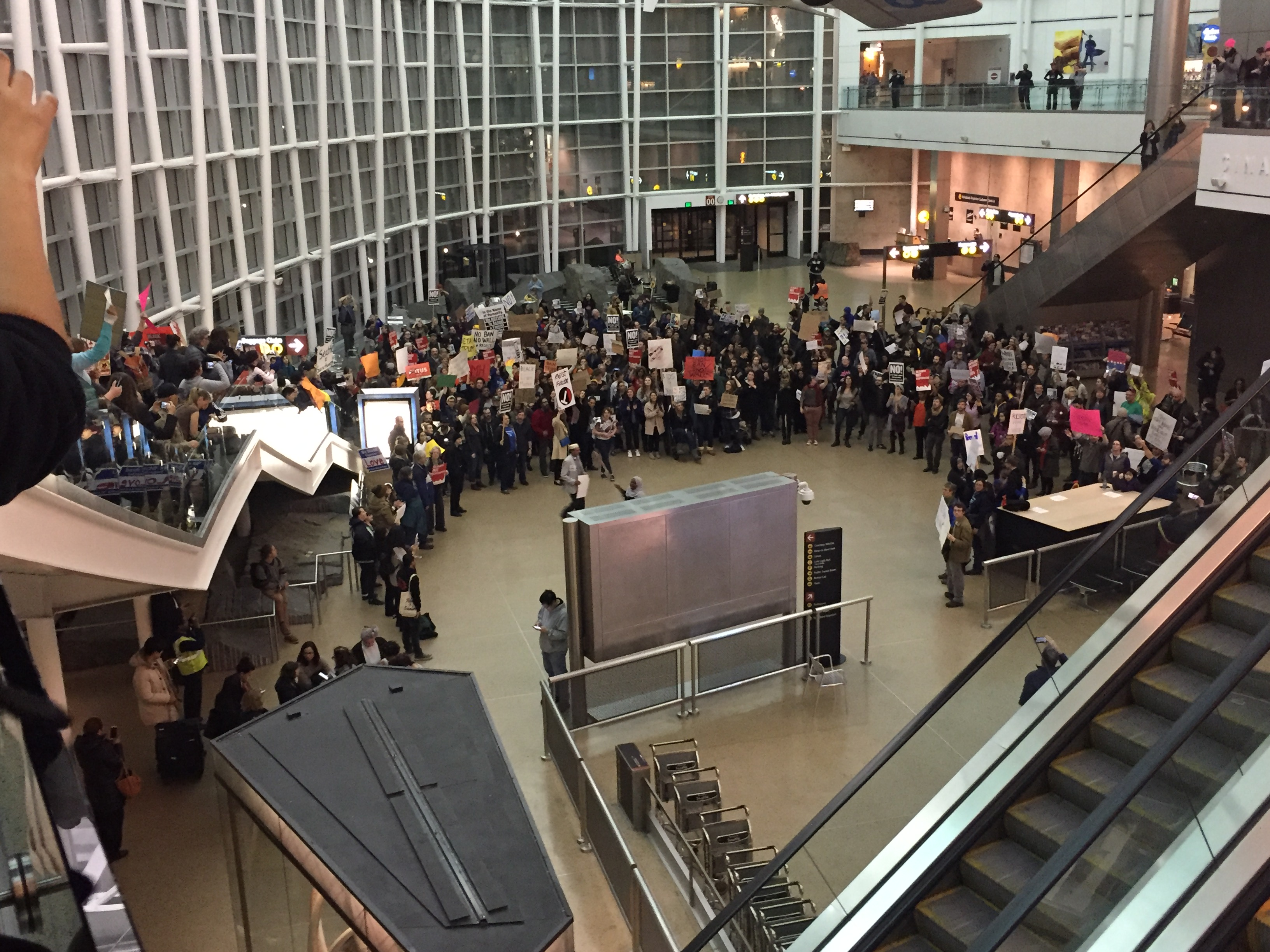 UAW 4121 members join hundreds in the Seattle community for an impromptu action at SeaTac airport protesting Trump's first immigration Executive Order.